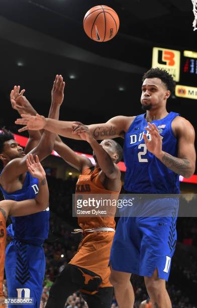 Matt Coleman of the Texas Longhorns and Gary Trent Jr of the Duke Blue Devils battle for a rebound during the second half of the game during the...