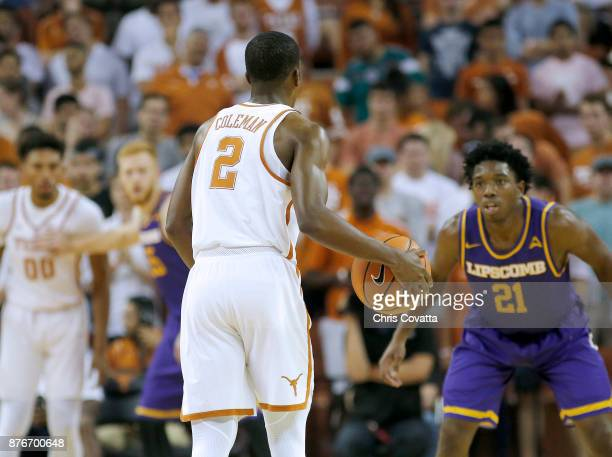 Matt Coleman of the Texas Longhorns brings the ball up court against Kenny Cooper of the Lipscomb Bisons at the Frank Erwin Center on November 18...