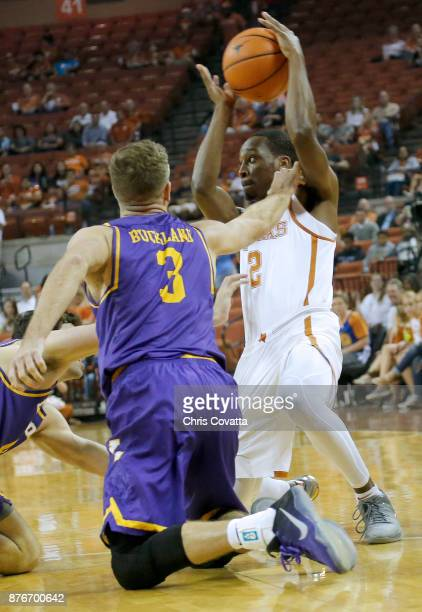 Matt Coleman of the Texas Longhorns holds the ball away from Michael Buckland of the Lipscomb Bisons at the Frank Erwin Center on November 18 2017 in...