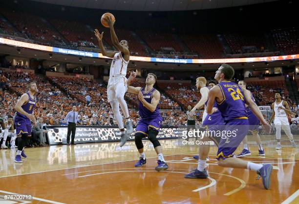 Matt Coleman of the Texas Longhorns leaps to the basket past Michael Buckland of the Lipscomb Bisons at the Frank Erwin Center on November 18 2017 in...