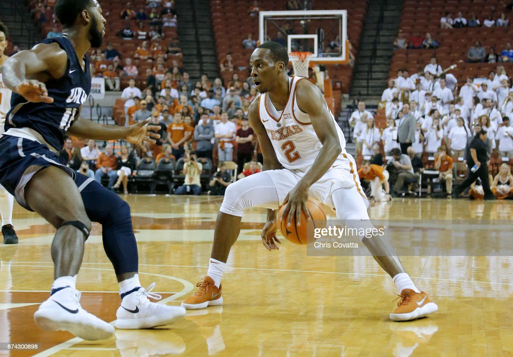 Matt Coleman #2 of the Texas Longhorns moves with the ball against Jordan Reed #11 of the New Hampshire Wildcats at the Frank Erwin Center on November 14, 2017 in Austin, Texas.