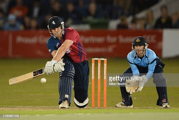 Matt Coles of Kent reverse sweeps as Callum Jackson of Sussex looks on during the Friends Life T20 match between Sussex Sharks and Kent Spitfires at...