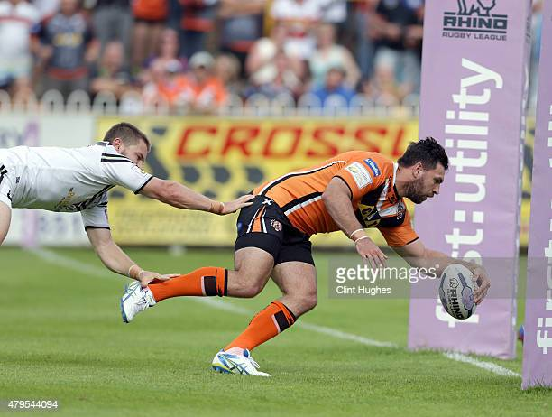Matt Cook of Castleford Tigers scores the fourth try for his side during the First Utility Super League match between Castleford Tigers and Widnes...