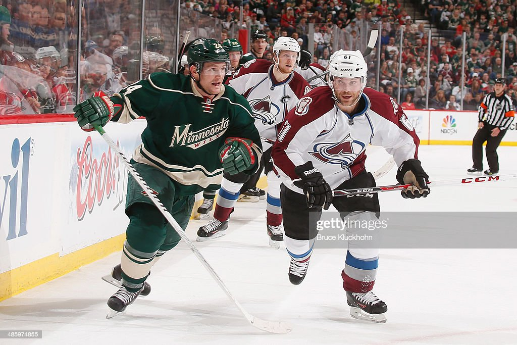 <a gi-track='captionPersonalityLinkClicked' href=/galleries/search?phrase=Matt+Cooke&family=editorial&specificpeople=592551 ng-click='$event.stopPropagation()'>Matt Cooke</a> #24 of the Minnesota Wild and Andre Benoit #61 of the Colorado Avalanche skate to the puck during Game Three of the First Round of the 2014 Stanley Cup Playoffs on April 21, 2014 at the Xcel Energy Center in St. Paul, Minnesota.