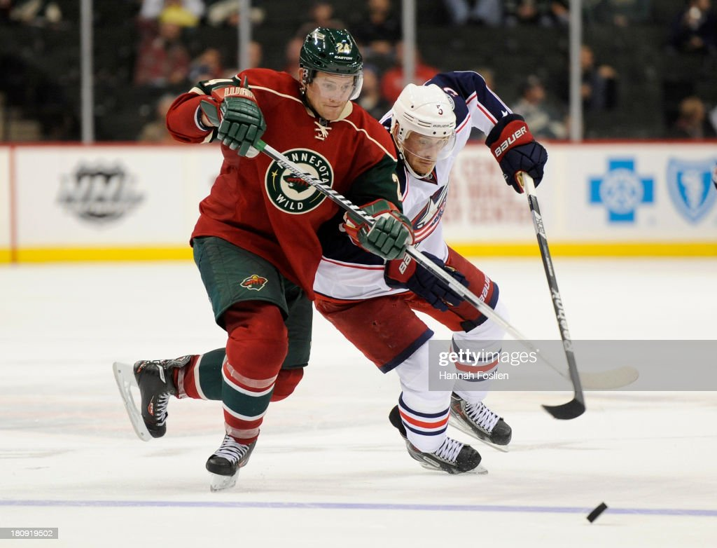 <a gi-track='captionPersonalityLinkClicked' href=/galleries/search?phrase=Matt+Cooke&family=editorial&specificpeople=592551 ng-click='$event.stopPropagation()'>Matt Cooke</a> #24 of the Minnesota Wild and <a gi-track='captionPersonalityLinkClicked' href=/galleries/search?phrase=Jack+Skille&family=editorial&specificpeople=697014 ng-click='$event.stopPropagation()'>Jack Skille</a> #5 of the Columbus Blue Jackets go after the puck during the third period of the preseason game on September 17, 2013 at Xcel Energy Center in St Paul, Minnesota. The Blue Jackets defeated the Wild 3-1.