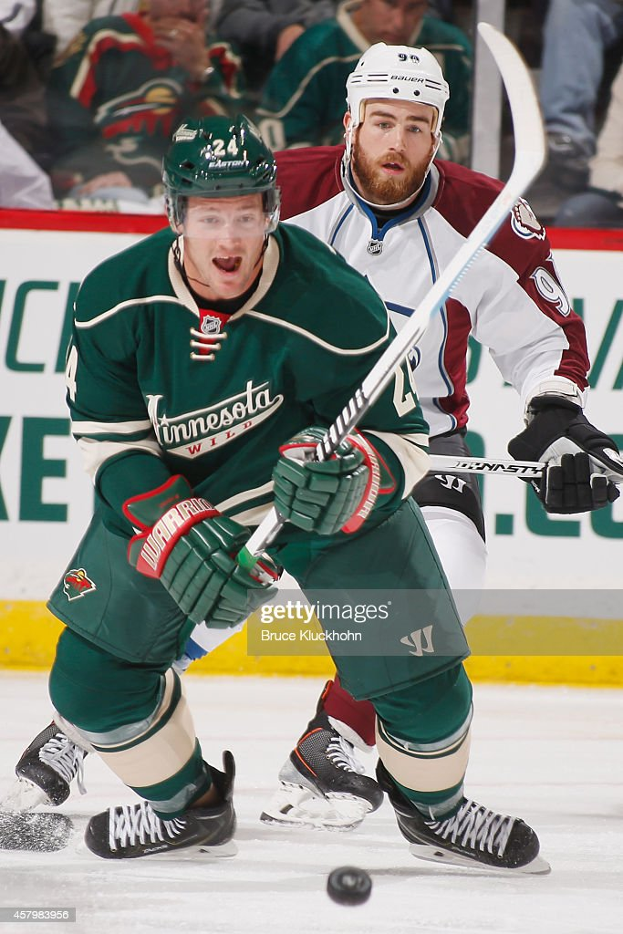 Matt Cooke of the Minnesota Wild and Ryan O'Reilly of the Colorado Avalanche skate to the puck during the season opener on October 9 2014 at the Xcel...
