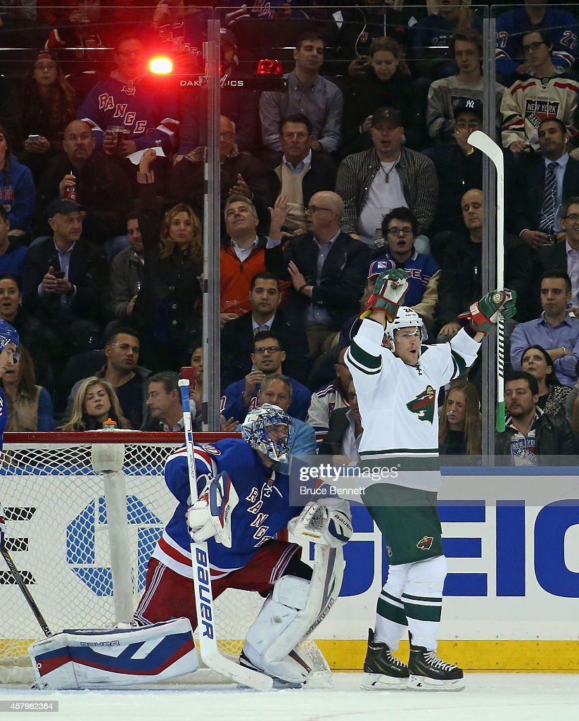 Matt Cooke of the Minnesota Wild celebrates his goal at 624 of the second period against Henrik Lundqvist of the New York Rangers at Madison Square...