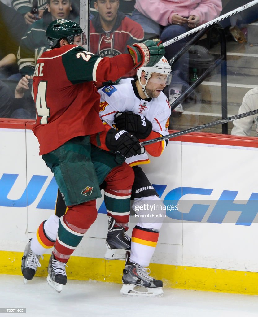 <a gi-track='captionPersonalityLinkClicked' href=/galleries/search?phrase=Matt+Cooke&family=editorial&specificpeople=592551 ng-click='$event.stopPropagation()'>Matt Cooke</a> #24 of the Minnesota Wild checks Chris Butler #44 of the Calgary Flames into the boards during the third period of the game on March 3, 2014 at Xcel Energy Center in St Paul, Minnesota. The Wild defeated the Flames 3-2.