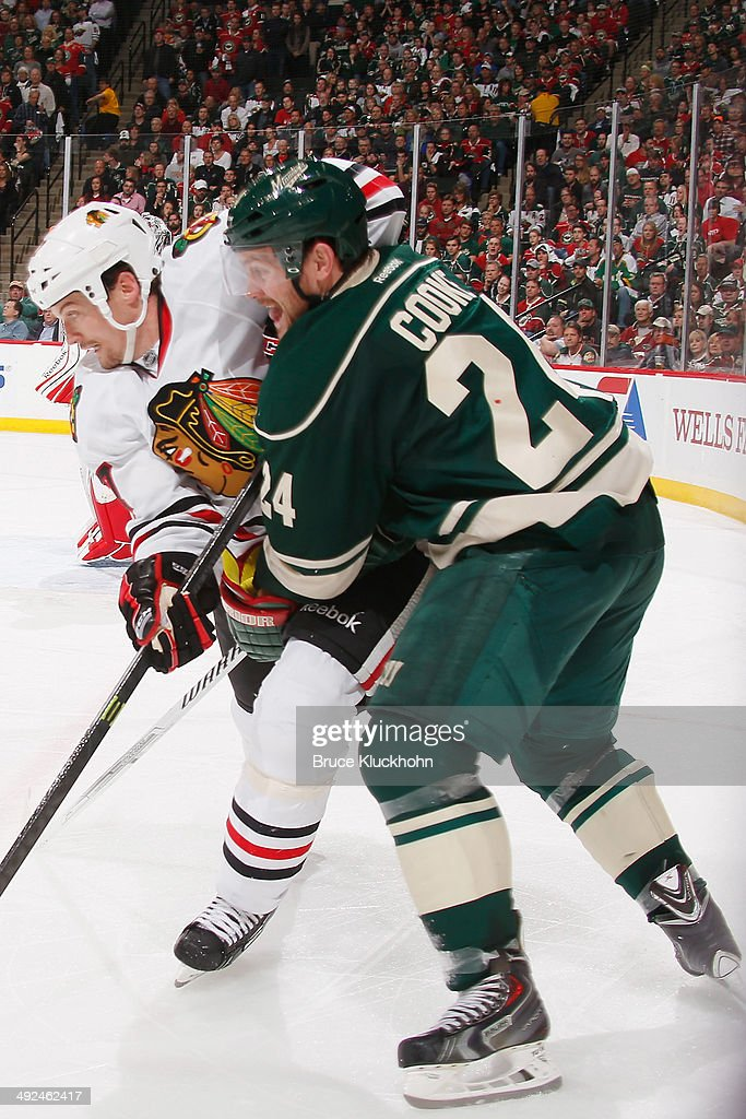 Matt Cooke of the Minnesota Wild defends a member of the Chicago Blackhawks during Game Six of the Second Round of the 2014 Stanley Cup Playoffs on...