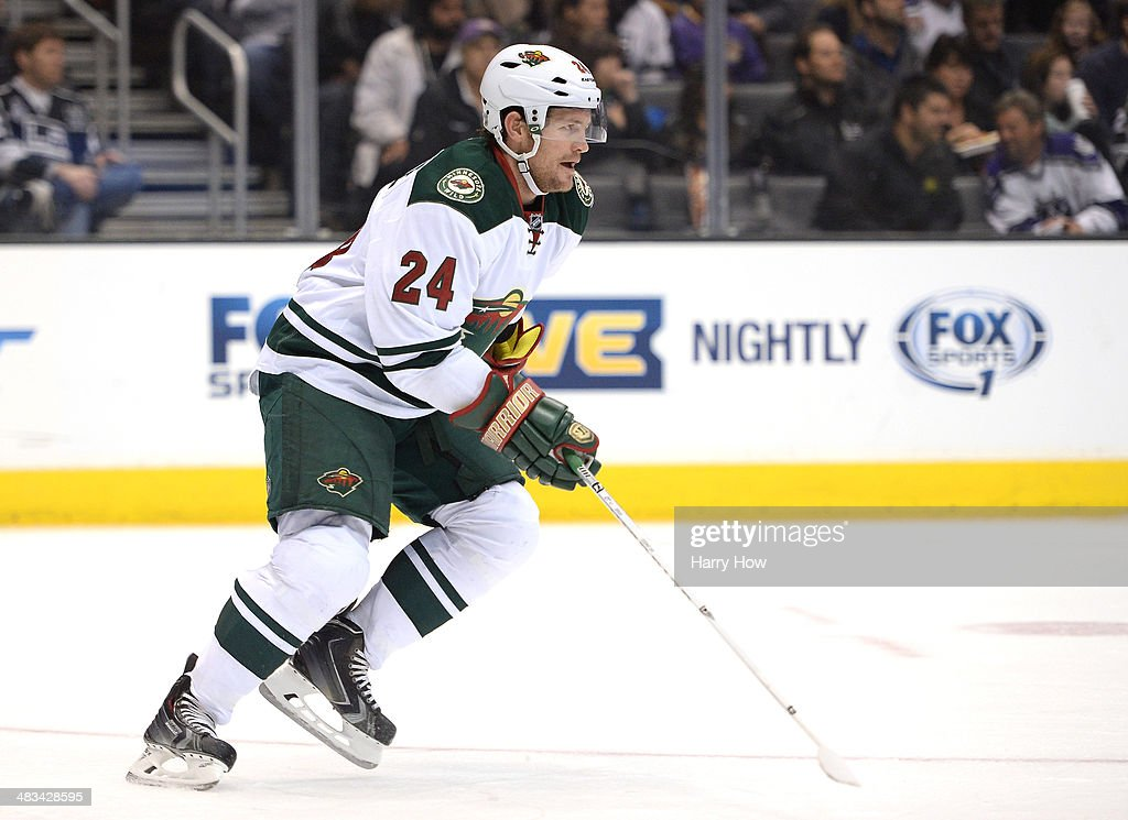 Matt Cooke of the Minnesota Wild forechecks against the Los Angeles Kings at Staples Center on March 31 2014 in Los Angeles California