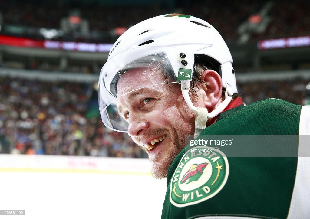 Matt Cooke of the Minnesota Wild looks on from the bench during their NHL game against the Vancouver Canucks at Rogers Arena February 28 2014 in...