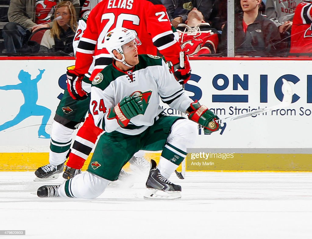 Matt Cooke of the Minnesota Wild reacts after scoring a thirdperiod goal against the New Jersey Devils during the game at the Prudential Center on...