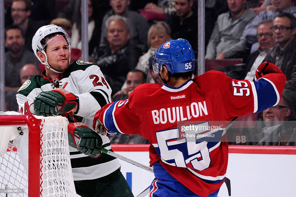 Matt Cooke #24 of the Minnesota Wild shoves Francis Bouillon #55 of the Montreal Canadiens during the NHL game at the Bell Centre on November 19, 2013 in Montreal, Quebec, Canada