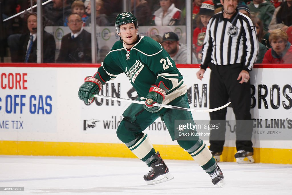Matt Cooke of the Minnesota Wild skates against the Colorado Avalanche during the game on November 29 2013 at the Xcel Energy Center in St Paul...