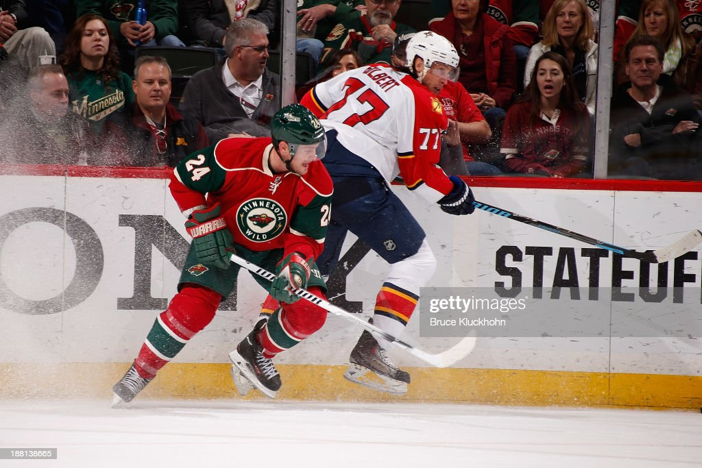 <a gi-track='captionPersonalityLinkClicked' href=/galleries/search?phrase=Matt+Cooke&family=editorial&specificpeople=592551 ng-click='$event.stopPropagation()'>Matt Cooke</a> #24 of the Minnesota Wild skates against <a gi-track='captionPersonalityLinkClicked' href=/galleries/search?phrase=Tom+Gilbert&family=editorial&specificpeople=687083 ng-click='$event.stopPropagation()'>Tom Gilbert</a> #77 of the Florida Panthers during the game on November 15, 2013 at the Xcel Energy Center in St. Paul, Minnesota.