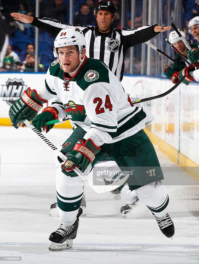 Matt Cooke of the Minnesota Wild skates during an NHL hockey game against the New York Islanders at Nassau Veterans Memorial Coliseum on March 18...