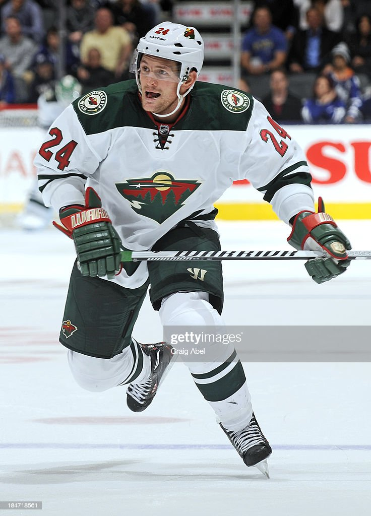 <a gi-track='captionPersonalityLinkClicked' href=/galleries/search?phrase=Matt+Cooke&family=editorial&specificpeople=592551 ng-click='$event.stopPropagation()'>Matt Cooke</a> #24 of the Minnesota Wild skates during NHL game action against the Toronto Maple Leafs October 15, 2013 at Air Canada Centre in Toronto, Ontario, Canada.