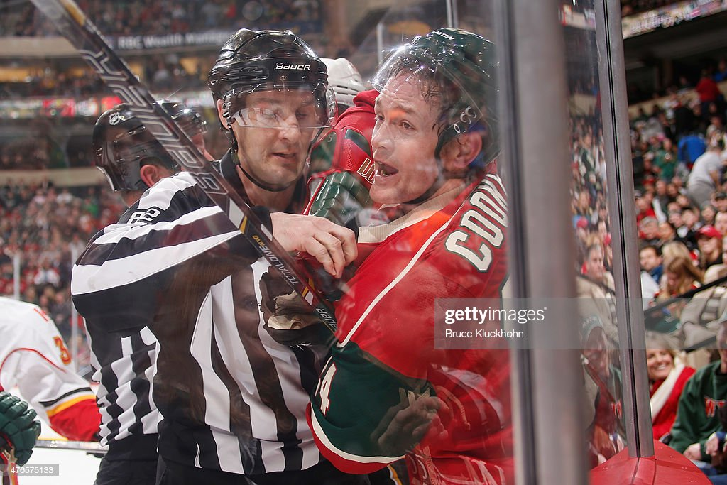 <a gi-track='captionPersonalityLinkClicked' href=/galleries/search?phrase=Matt+Cooke&family=editorial&specificpeople=592551 ng-click='$event.stopPropagation()'>Matt Cooke</a> #24 of the Minnesota Wild voices his displeasure while linesman Ryan Galloway separates him from a member of the Calgary Flames during the game on March 3, 2014 at the Xcel Energy Center in St. Paul, Minnesota.