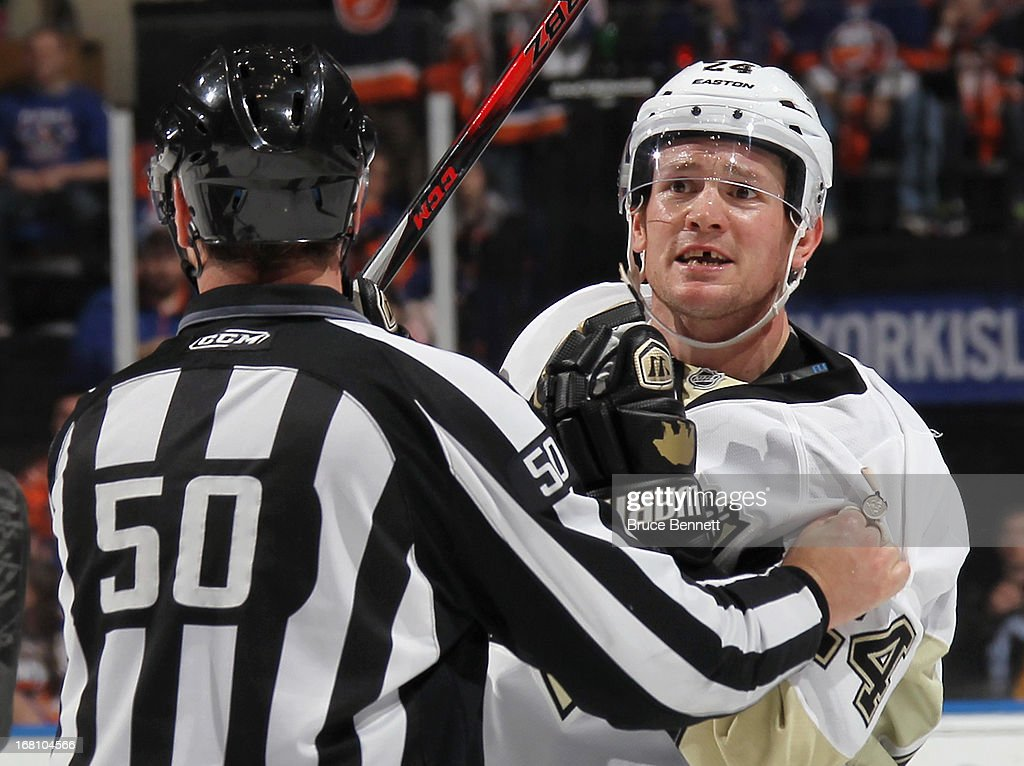 Matt Cooke #24 of the Pittsburgh Penguins argues a call in the game against the Pittsburgh Penguins in Game Three of the Eastern Conference Quarterfinals during the 2013 NHL Stanley Cup Playoffs at the Nassau Veterans Memorial Coliseum on May 5, 2013 in Uniondale, New York.