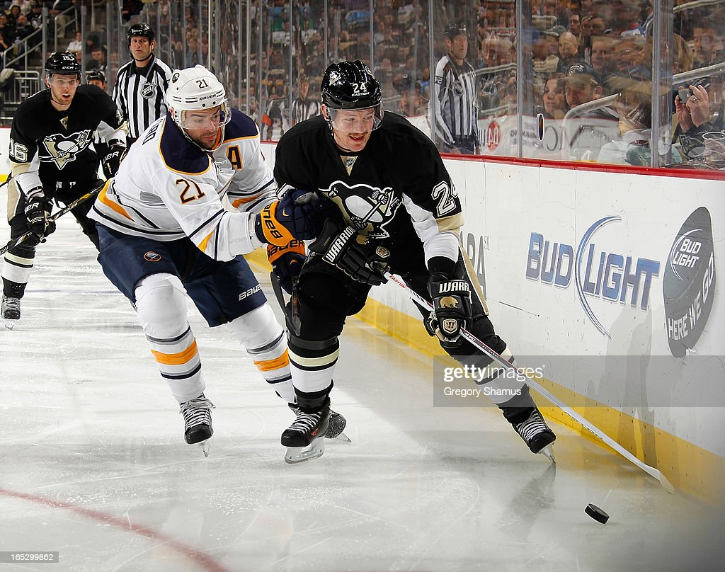 <a gi-track='captionPersonalityLinkClicked' href=/galleries/search?phrase=Matt+Cooke&family=editorial&specificpeople=592551 ng-click='$event.stopPropagation()'>Matt Cooke</a> #24 of the Pittsburgh Penguins battles for the loose puck against <a gi-track='captionPersonalityLinkClicked' href=/galleries/search?phrase=Drew+Stafford&family=editorial&specificpeople=220617 ng-click='$event.stopPropagation()'>Drew Stafford</a> #21 of the Buffalo Sabres on April 2, 2013 at Consol Energy Center in Pittsburgh, Pennsylvania.