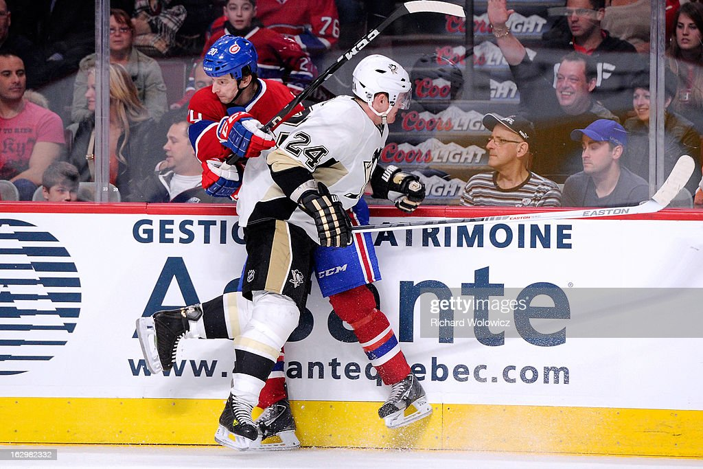 <a gi-track='captionPersonalityLinkClicked' href=/galleries/search?phrase=Matt+Cooke&family=editorial&specificpeople=592551 ng-click='$event.stopPropagation()'>Matt Cooke</a> #24 of the Pittsburgh Penguins body checks <a gi-track='captionPersonalityLinkClicked' href=/galleries/search?phrase=Colby+Armstrong&family=editorial&specificpeople=597839 ng-click='$event.stopPropagation()'>Colby Armstrong</a> #20 of the Montreal Canadiens during the NHL game at the Bell Centre on March 2, 2013 in Montreal, Quebec, Canada. The Penguins defeated the Canadiens 7-6 in overtime.