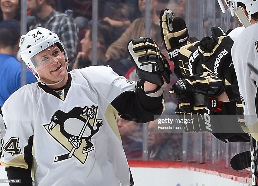 <a gi-track='captionPersonalityLinkClicked' href=/galleries/search?phrase=Matt+Cooke&family=editorial&specificpeople=592551 ng-click='$event.stopPropagation()'>Matt Cooke</a> #24 of the Pittsburgh Penguins celebrates a goal with teammates during the NHL game on March 2, 2013 at the Bell Centre in Montreal, Quebec, Canada.