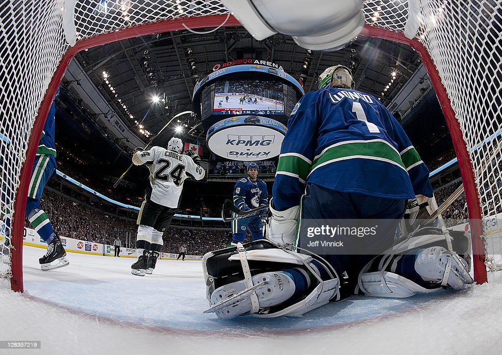 Matt Cooke of the Pittsburgh Penguins celebrates after scoring against Roberto Luongo of the Vancouver Canucks during the NHL game October 6 2011 in...