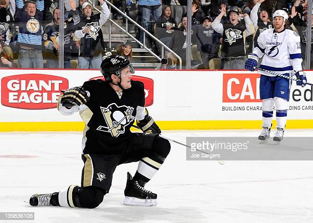 Matt Cooke of the Pittsburgh Penguins celebrates his goal in front of Ryan Malone of the Tampa Bay Lightning on February 25 2012 at Consol Energy...