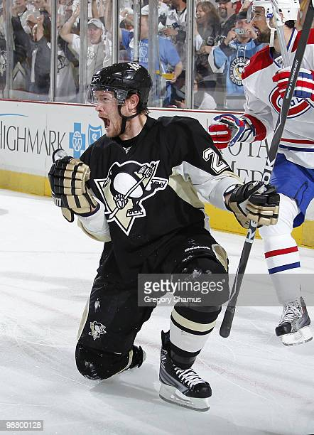 Matt Cooke of the Pittsburgh Penguins celebrates his goal in front of Ryan O'Byrne of the Montreal Canadiens in Game Two of the Eastern Conference...