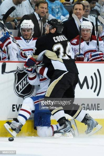 Matt Cooke of the Pittsburgh Penguins checks Brian Gionta of the Montreal Canadiens off the puck in Game Two of the Eastern Conference Semifinals...