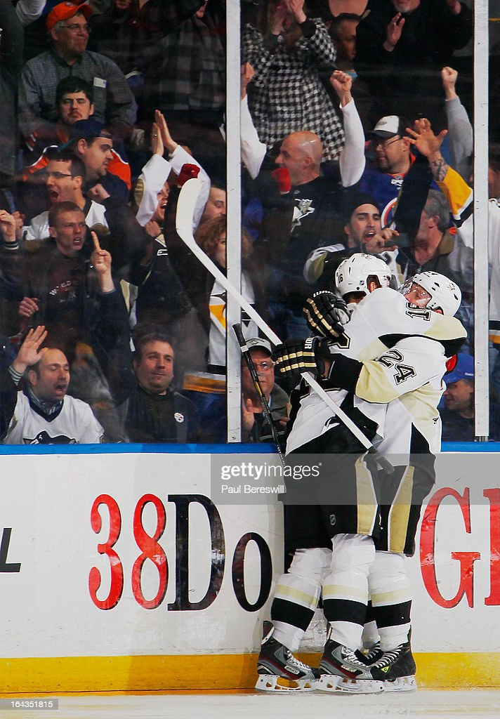 Matt Cooke #24 of the Pittsburgh Penguins congratulates teammate Brandon Sutter #16 on his third-period goal at 1:46 against the New York Islanders in an NHL hockey game at Nassau Veterans Memorial Coliseum on March 22, 2013 in Uniondale, New York. The Penguins defeated the Islanders 4-2.