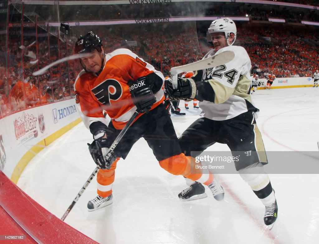 Matt Cooke of the Pittsburgh Penguins hits Pavel Kubina of the Philadelphia Flyers in Game Three of the Eastern Conference Quarterfinals during the...