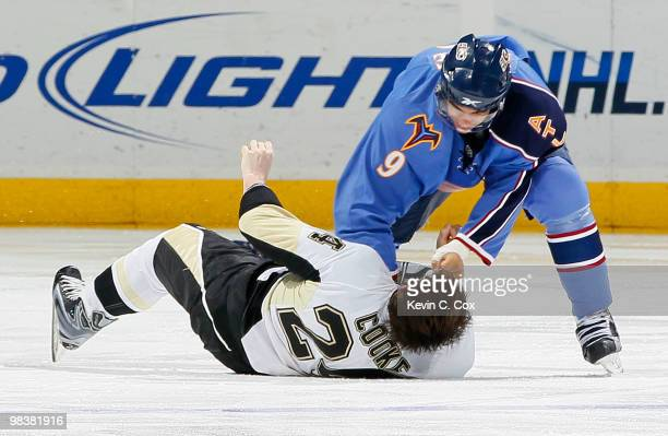 Matt Cooke of the Pittsburgh Penguins is knocked out by this righthanded punch from Evander Kane of the Atlanta Thrashers at Philips Arena on April...
