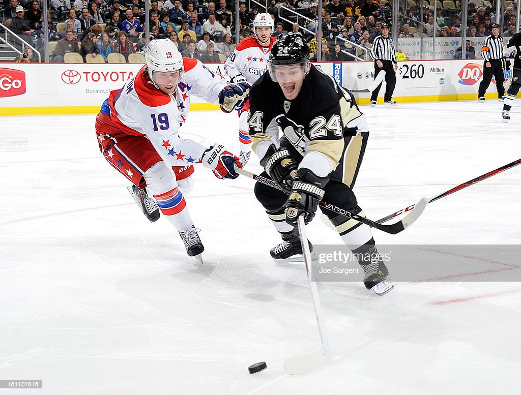 <a gi-track='captionPersonalityLinkClicked' href=/galleries/search?phrase=Matt+Cooke&family=editorial&specificpeople=592551 ng-click='$event.stopPropagation()'>Matt Cooke</a> #24 of the Pittsburgh Penguins reaches for the loose puck in front of Nicklas Backstrom #19 of the Washington Capitals on March 19, 2013 at Consol Energy Center in Pittsburgh, Pennsylvania. Pittsburgh won the game 2-1.