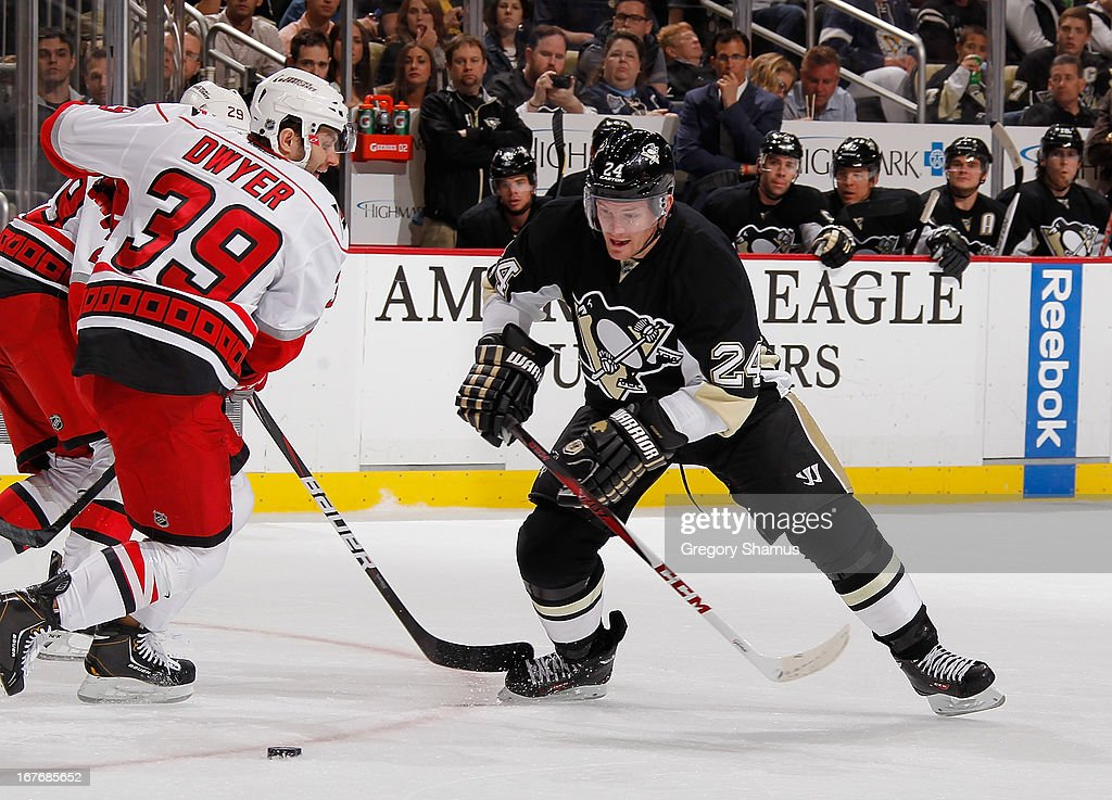 <a gi-track='captionPersonalityLinkClicked' href=/galleries/search?phrase=Matt+Cooke&family=editorial&specificpeople=592551 ng-click='$event.stopPropagation()'>Matt Cooke</a> #24 of the Pittsburgh Penguins skates for the loose puck in front of Patrick Dwyer #39 of the Carolina Hurricanes on April 27, 2013 at Consol Energy Center in Pittsburgh, Pennsylvania. Pittsburgh won the game 8-3.