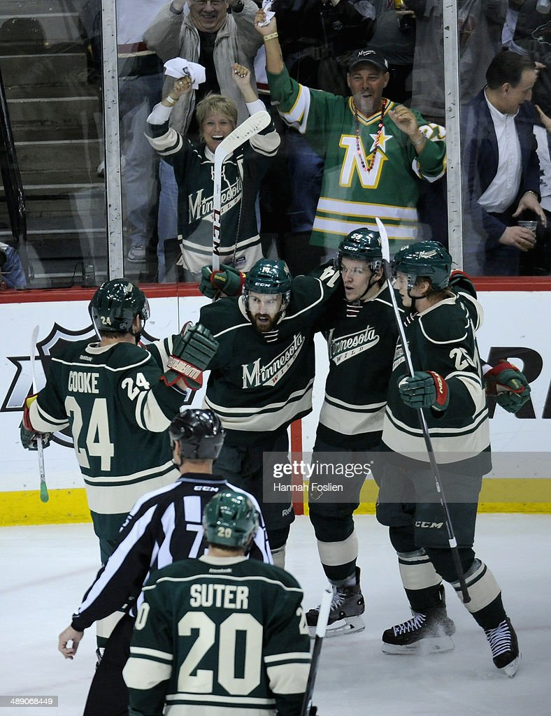 Matt Cooke #24, Ryan Suter #20 Justin Fontaine, Erik Haula #56 and Jonas Brodin #25 of the Minnesota Wild celebrate a goal against the Chicago Blackhawks by Fontaine during the first period in Game Four of the Second Round of the 2014 NHL Stanley Cup Playoffs on May 9, 2014 at Xcel Energy Center in St Paul, Minnesota.