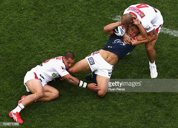 Matt Cooper and Jeremy Smith of the Dragons tackles Sam Perrett of the Roosters during the NRL Grand Final match between the St George Illawarra...