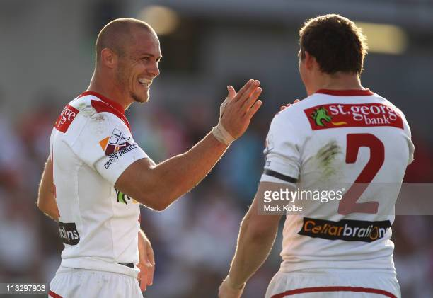Matt Cooper of the Dragons celebrates with Brett Morris of the Dragons after scoring a try during the round eight NRL match between the St George...
