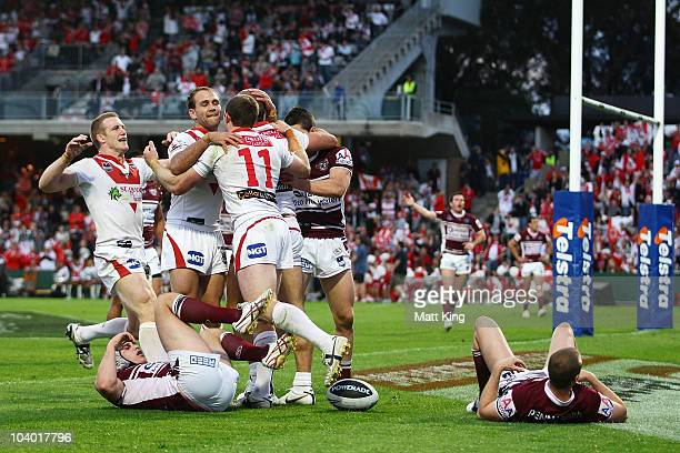 Matt Cooper of the Dragons celebrates with team mates after scoring his first try during the NRL Fourth Qualifying Final match between the St George...