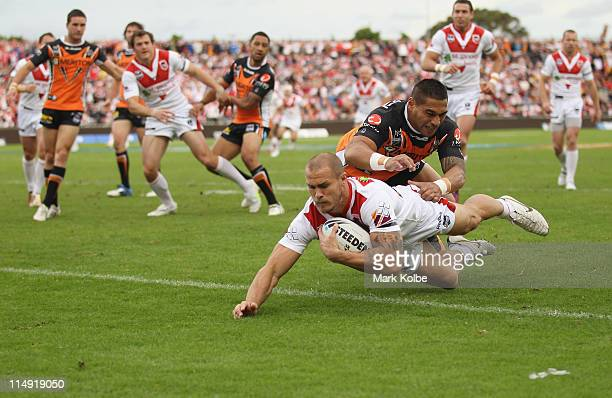 Matt Cooper of the Dragons dives over to score a try during the round 12 NRL match between the St George Illawarra Dragons and the Wests Tigers at...