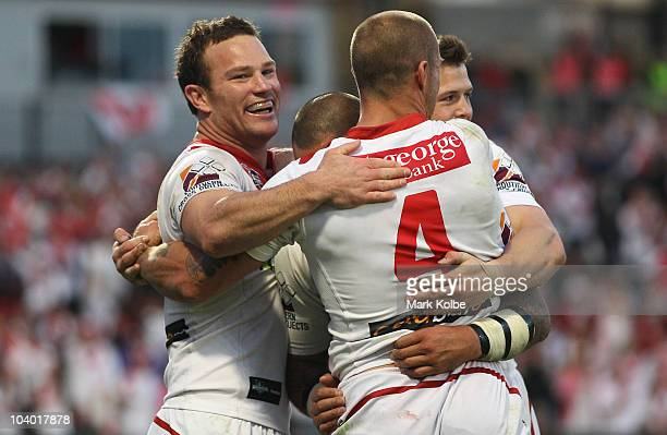Matt Cooper of the Dragons is congratulated by his team mates after he scored a try during the NRL Fourth Qualifying Final match between the St...