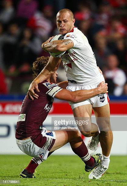 Matt Cooper of the Dragons is tackled by Daly CherryEvans of the Sea Eagles during the round four NRL match between the St George Illawarra Dragons...