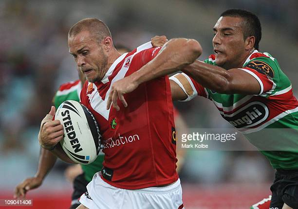 Matt Cooper of the Dragons is tackled during the NRL Charity Shield match between the South Sydney Rabbitohs and the St George Illawarra Dragons at...