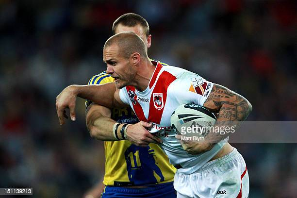 Matt Cooper of the Dragons is tackled during the round 26 NRL match between the Parramatta Eels and the St George Illawarra Dragons at ANZ Stadium on...