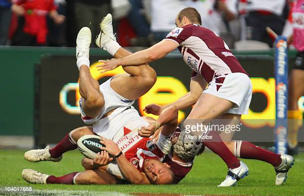 Matt Cooper of the Dragons is upended as he scores a try during the NRL Fourth Qualifying Final match between the St George Illawarra Dragons and the...