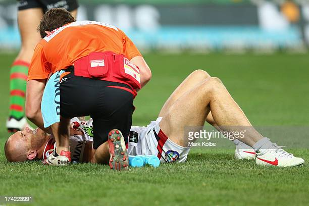 Matt Cooper of the Dragons lies injured on the ground during the round 19 NRL match between the South Sydney Rabbitohs and the St George Illawarra...
