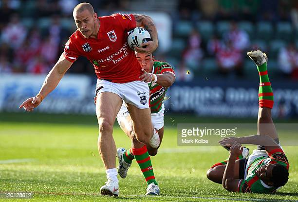 Matt Cooper of the Dragons makes a break during the round 21 NRL match between the St GeorgeIllawarra Dragons and the South Sydney Rabbitohs at WIN...