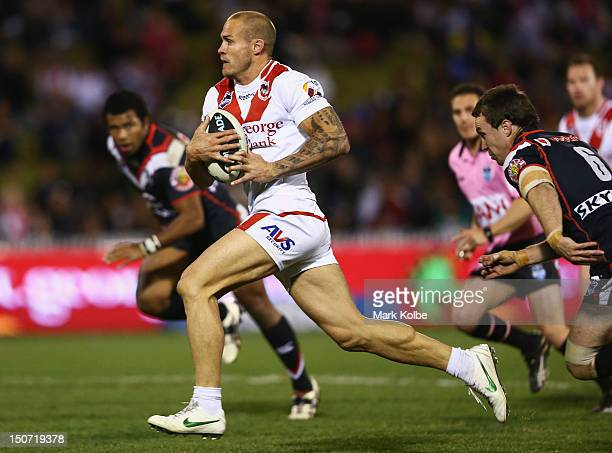 Matt Cooper of the Dragons makes a break during the round 25 NRL match between the St George Dragons and the New Zealand Warriors at WIN Stadium on...