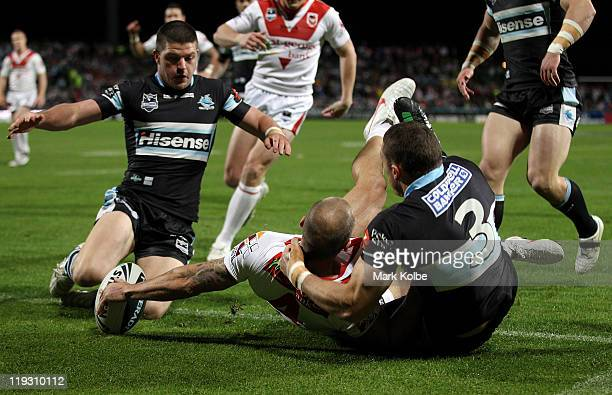 Matt Cooper of the Dragons scores a try during the round 19 NRL match between the St George Illawarra Dragons and the Cronulla Sharks at WIN Jubilee...