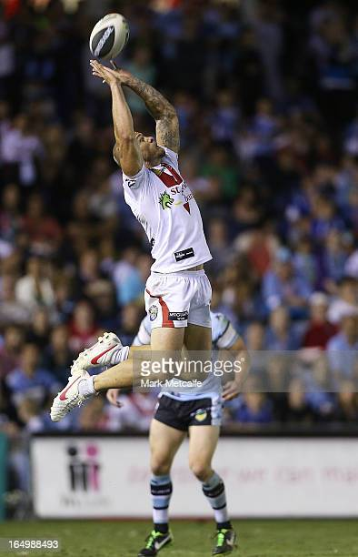 Matt Cooper of the Dragons takes a high ball during the round four NRL match between the Cronulla Sharks and the St George Illawarra Dragons at...